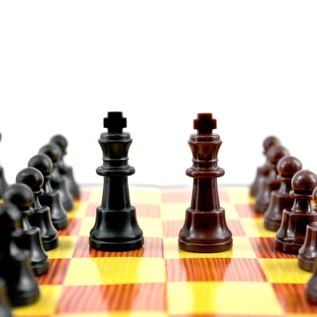 fighting between of the leader on chess board